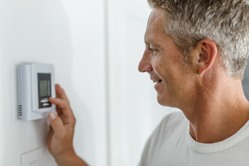 Residential Heating Oil Customer Setting Thermostat